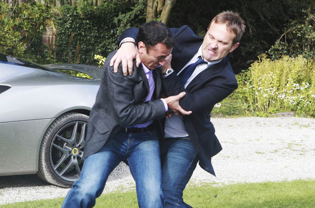 Declan Macey (Jason Merrells) and Jai Sharma (Chris Bisson) fight