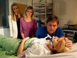 Stella is unconscious, Karl, Eva and Leanne look on