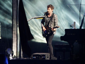 Matt Bellamy of Muse performing on the Main Stage at the Reading Festival