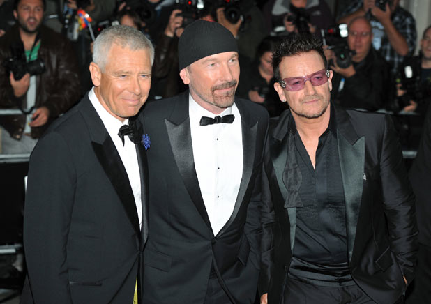 U2 arriving at the 2011 GQMen of the Year Awards