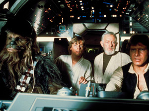Hitching a ride with Han Solo (Harrison Ford) and Chewbacca (Peter Mayhew) on the Millennium Falcon