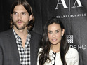 Ashton Kutcher and Demi Moore attend a service at LA's Kabbalah Center.