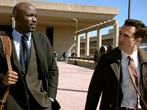 Mike Colter as Malcolm Ward and Nestor Carbonell as Victor Machado on Ringer