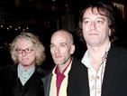 Mike Mills downplays reunion speculation following Green's 25th anniversary.