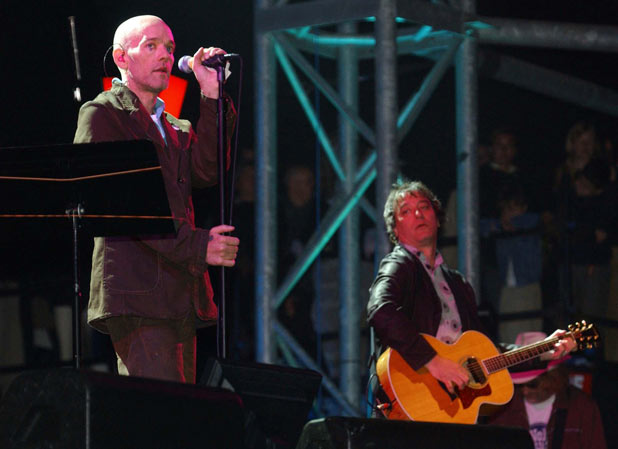 Michael Stipe and Peter Buck on stage as R.E.M. make another appearance at Glastonbury Festival in 2003