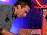 Chris Martin from Coldplay performing on stage
