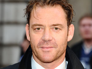 Marton Csokas struts his stuff before the premiere of the Nazi-hunting drama