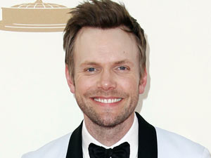 Joel McHale on the red carpet at the 63rd Primetime Emmy Awards