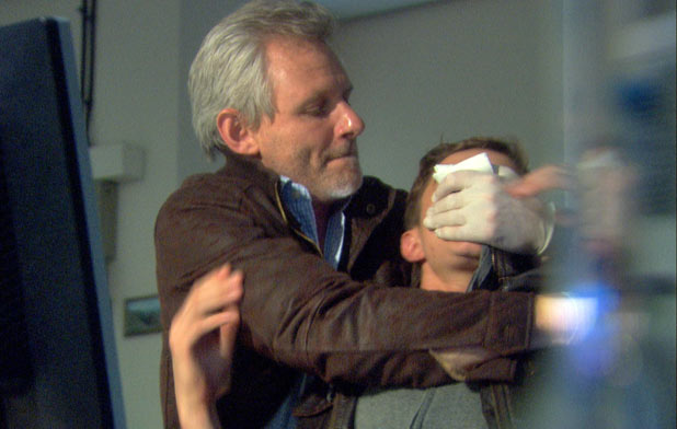 Harrison (James Larkin) attacks Jack Hollins (Nicolas Woodman)