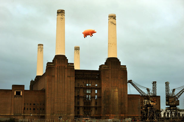 A giant inflatable pig flies above Battersea Power Station to celebrate the release of 'Why Pink Floyd'