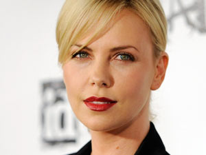 Charlize Theron poses at the official launch party for the video game &quot;Rage