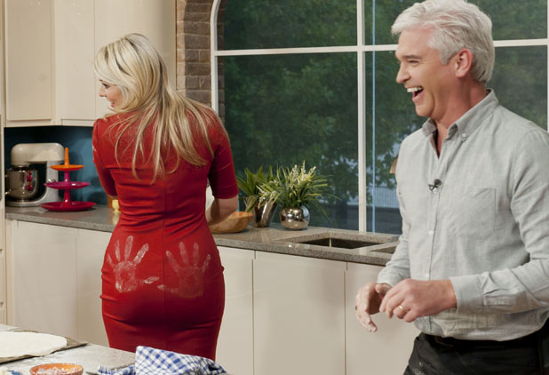 Phillip Schofield puts hand prints on Holly Willoughby's bottom