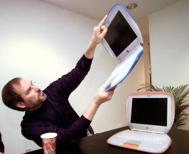 Steve holds up an 'iBook'
