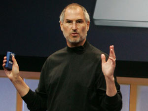 Steve Jobs gestures in front of the Apple MacBook Pro laptop at Apple headquarters, 2006