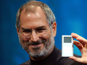 Steve Jobs displays the iPod mini at the Macworld Conference and Expo, San Francisco, 2004