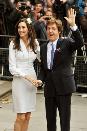 Sir Paul McCartney and Nancy Shevell arrive at the registry office.