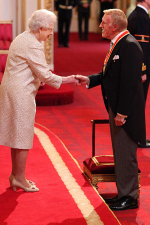 Sir Bruce Forsyth is knighed by the Queen