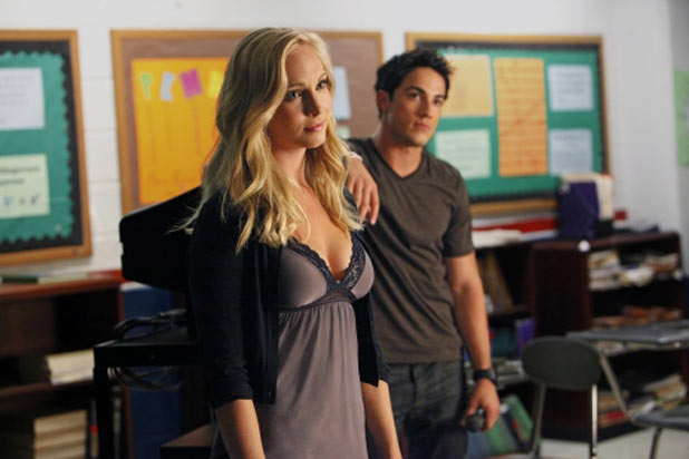 Candice Accola as Caroline and Michael Trevino as Tyler