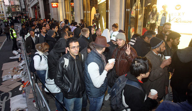 People queue at the Apple Store