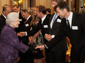 The actor is among 350 Australian guests to meet the Queen at Buckingham Palace.