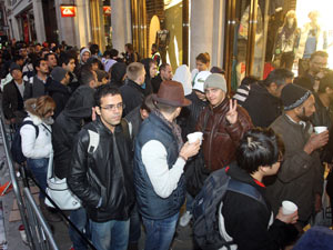 People queue at the Apple Store in Regents Street, London, as they wait to buy the iPhone 4S