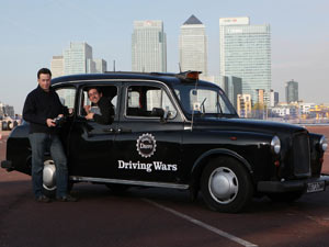 Dr James Brighton and Colin Murray unveil the world's first remote controlled black cab in London