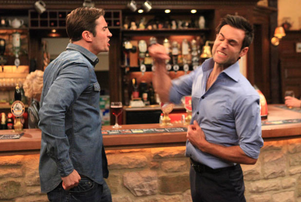 Nikhil Sharma (Rik Makarem) punches Nicky Pritchard (Matt Milburn)