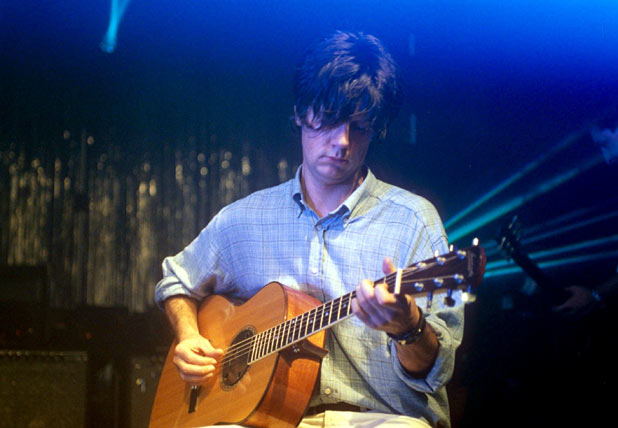 John Squire during a Stone Rosees performance