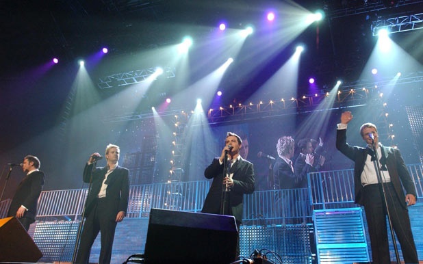 Westlife performing during the Christmas in Popworld music concert - a live festive edition of the Channel 4 tv show, 2004