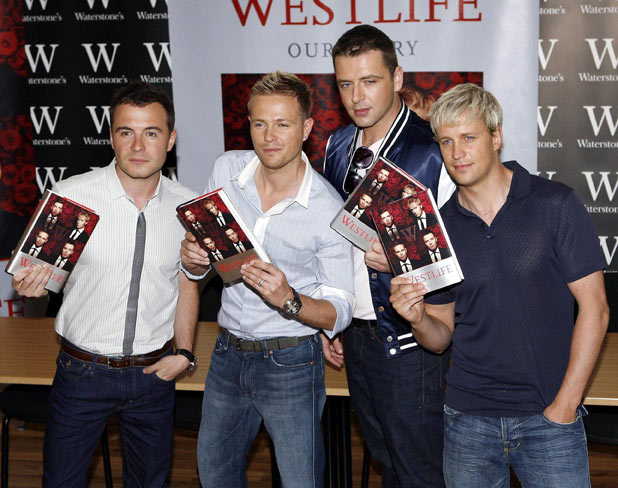 Westlife sign copies of their autobiography