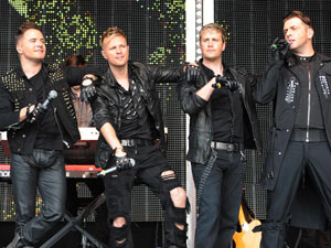 Westlife perform on stage during Ladies Day at Newbury Races, Berkshire