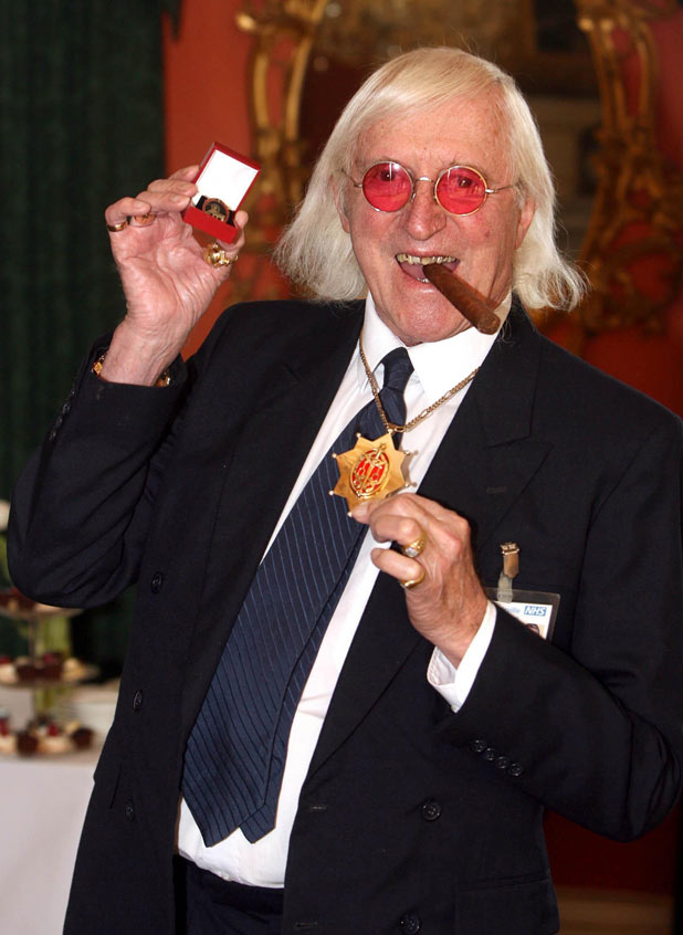 Sir Jimmy Savile after he received a commemorative badge from Prime Minister Gordon Brown at Downing Street in London for his work as a 'Bevin Boy' in 2008