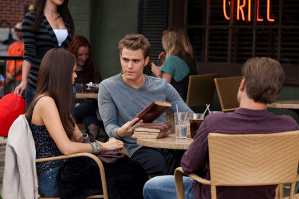 Nina Dobrev as Elena, Paul Wesley as Stefan, and Matt Davis as Alaric