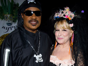 Stevie Wonder and Bette Midler attend Midler's Hulaween gala benefit for the New York Restoration Project.