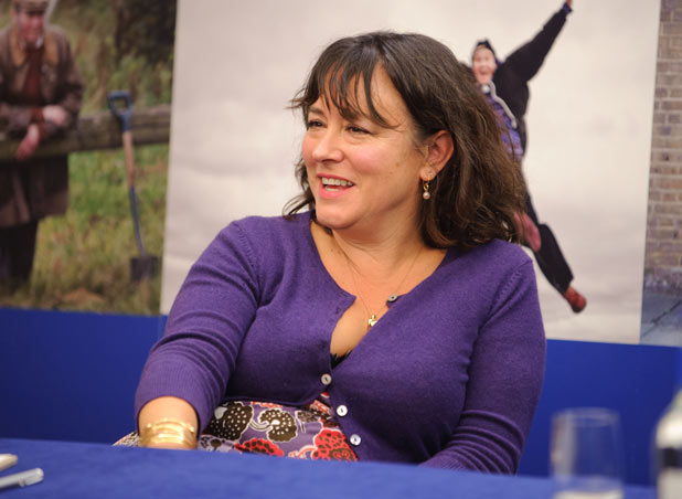Arabella Weir backed by an image of Brilliant Paul Whitehouse