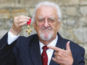 Bernard Cribbins is awarded an OBE at Windsor Castle for his long career.