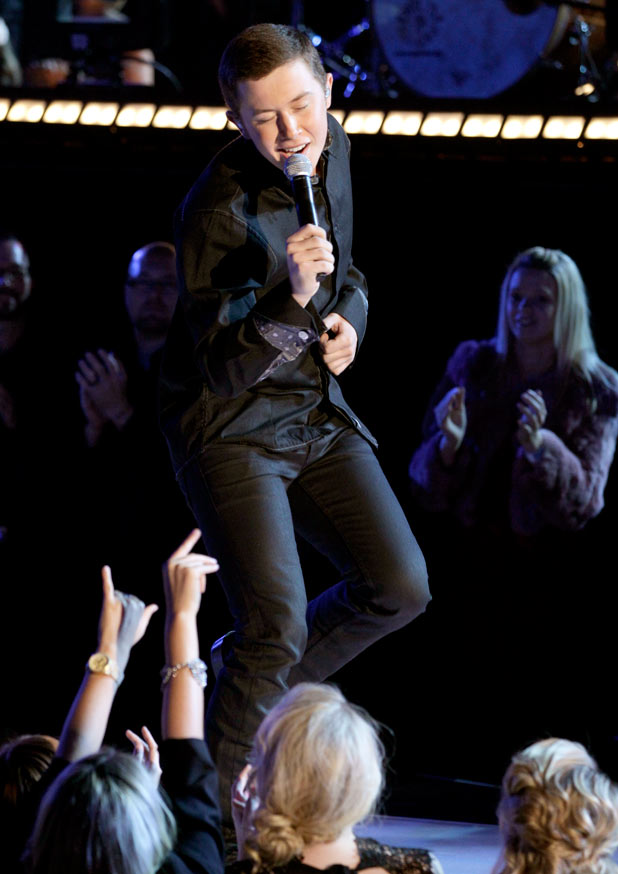 American Idol season 10 winner Scotty McCreery plays to the crowd during a rendition of 'Walk in the Country'.