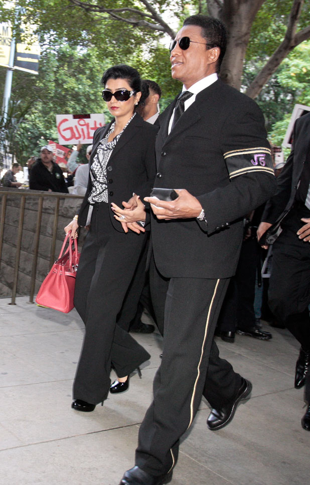 Michael Jackson's brother Jermaine Jackson and his wife Halima Rashid arrive at the courthouse after it was announced that jurors had reached a verdict