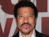 Hello... is it me you&#39;re looking for? Lionel Richie beams on the red carpet.