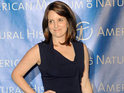 Tina Fey accepts blame for her 30 Rock co-star  being kicked off a plane.