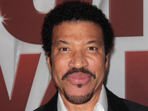 Hello... is it me you're looking for? Lionel Richie beams on the red carpet.