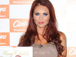 Amy Childs signs copies of her calendar at Bluewater shopping center