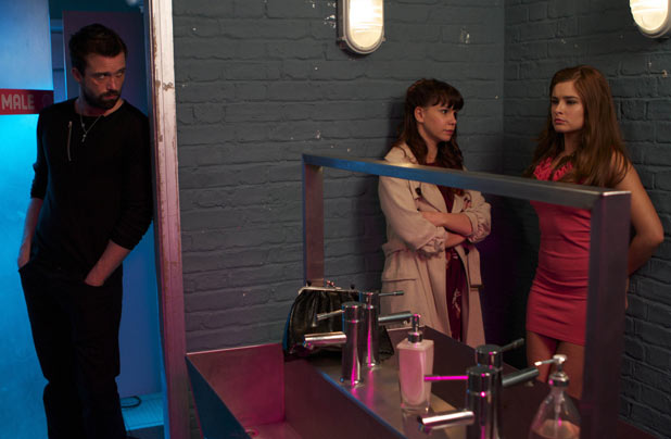 Brendan Brady (Emmett Scanlan) hears Nancy Hayton (Jessica Fox) and Mitzeee Minniver (Rachel Shenton) talking
