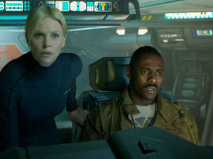 Charlize Theron and Idris Elba on board the ship Prometheus.