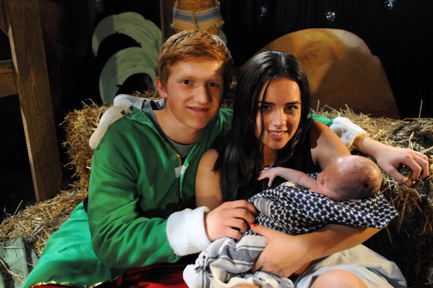 Chesney and Katy hold the new born baby