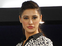 Nargis Fakhri reveals she cried about rumors she is dating Ranbir Kapoor.