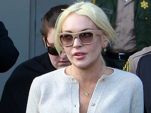Lindsay Lohan leaving Los Angeles County Superior Court after attending a progress report hearing, relating to her recent conviction for a probation violation. Lohan was given top marks for her efforts by the judge Los Angeles