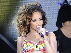 Singer Rihanna performing live on stage at the Palacio de los Deportes stadium.