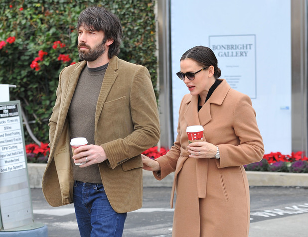 An expectant Jennifer Garner and husband Ben Affleck exit a toy store while looking for Christmas presents for their daughters Los Angeles