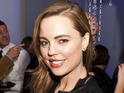 "Melissa George explains that she has been in ""such a good mood"" while pregnant."